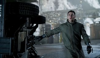 "This photo released by Warner Bros. Pictures shows Aaron Taylor-Johnson as Ford Brody in Warner Bros. Pictures' and Legendary Pictures' sci-fi action adventure, ""Godzilla,"" a Warner Bros. Pictures release. The film opens in theaters May 16, 2014. (AP Photo/Warner Bros. Pictures/Legendary Pictures, Kimberley French)"