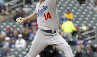 Los Angeles Dodgers starting pitcher Dan Haren (14) delivers to the Minnesota Twins during the first inning in the first baseball game of a doubleheader in Minneapolis, Thursday, May 1, 2014. (AP Photo/Ann Heisenfelt)