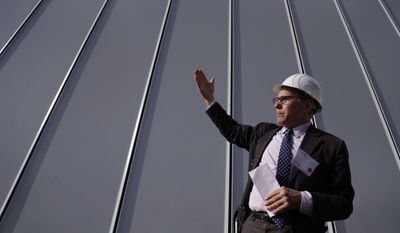 Scott Newman of Cooper, Robertson and Partners Architecture explains the outdoor space design during a tour of the future site for the Whitney Museum, Thursday, May 1, 2014, in New York.  The museum will open in its new location in lower Manhattan in the spring of 2015. (AP Photo/Julie Jacobson)