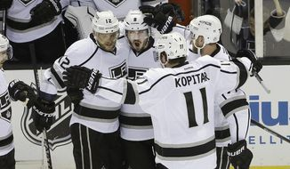 Los Angeles Kings defenseman Drew Doughty, second from left, celebrates with teammates after scoring a goal against the San Jose Sharks during the second period of Game 7 of an NHL hockey first-round playoff series in San Jose, Calif., Wednesday, April 30, 2014. (AP Photo)