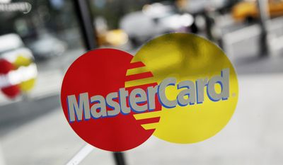 FILE  -  This Sept. 21, 2011, file photo. shows a MasterCard sign on a revolving door in New York. Mastercard Inc. reports quarterly earnings on Thursday, May 1, 2014.   (AP Photo/Mark Lennihan, File)