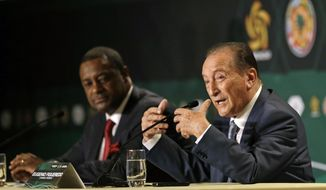 Eugenio Figueredo, right, president of CONMEBOL, the South American Football Confederation, gestures as he talks  during a news conference as CONCACAF president Jeffrey Webb, left, looks on in Bal Harbour, Fla., Thursday, May 1, 2014. The United States will host the Copa America soccer tournament for the first time in 2016. The Copa America, the world's oldest intercontinental soccer tournament, will celebrate its 100th anniversary in 2016. (AP Photo/Alan Diaz)