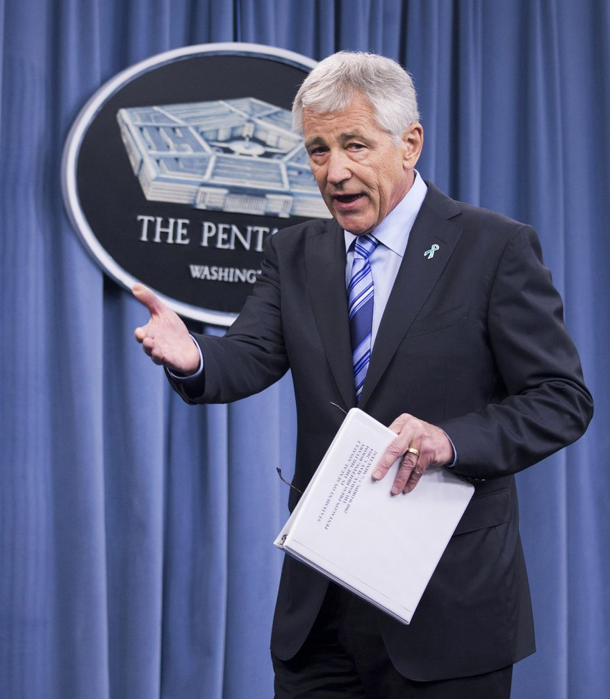 Defense Secretary Chuck Hagel introduces Sexual Assault Prevention and Response Office Director, Maj. Gen. Jeffrey Snow, during a news conferene about the Defense Department's sexual assault prevention and response program, Thursday, May 1, 2014, at the Pentagon.   (AP Photo/Manuel Balce Ceneta)