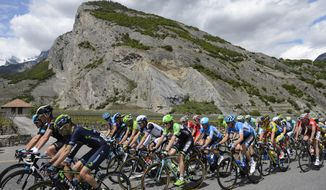 The pack of cyclists is in action during the second stage, a 166,5 km race from Sion to Montreux, at the 68th Tour de Romandie UCI ProTour cycling race in Chamoson, Switzerland, Thursday, May 1, 2014. (AP Photo/Keystone, Jean-Christophe Bott)