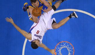 Golden State Warriors forward David Lee, top, puts up a shot as Los Angeles Clippers forward Hedo Turkoglu, of Turkey, falls to the floor during the second half in Game 5 of an opening-round NBA basketball playoff series, Tuesday, April 29, 2014, in Los Angeles. The Clippers won 113-103. (AP Photo)