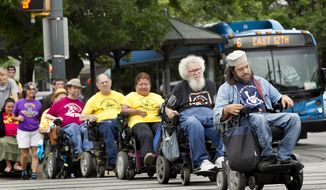 Members of  From front to back, Heiwa Salovitz, Bob Kafka, Renee Lopez, Mark Cundall and Gene Rodgers, members of the advocacy group ADAPT of Texas, cross the street, as they make their way to the Capitol on April 24, 2014 in Austin.  The group hopes to encourage legislators to improve accessibility for disabled people.   (AP Photo/Austin American-Statesman, Laura Skelding)  AUSTIN CHRONICLE OUT, COMMUNITY IMPACT OUT, INTERNET AND TV MUST CREDIT PHOTOGRAPHER AND STATESMAN.COM, MAGS OUT