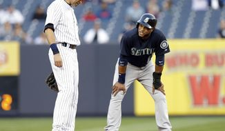 Seattle Mariners' Robinson Cano, right, talks to New York Yankees' Derek Jeter during the first inning of a baseball game Thursday, May 1, 2014, in New York. (AP Photo/Frank Franklin II)