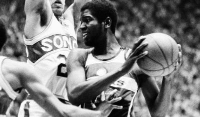Washington Bullets Bob Dandridge (right) tries to keep the ball from the grasp of Seattle Supersonics Gus Williams (left) and John Johnson (27) during NBA Championship Game at Seattle at night on Wednesday, June 7, 1978. (AP Photo)