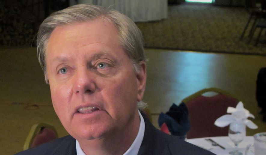 In this Sept. 3, 2013, file photo Sen. Lindsey Graham, R-S.C., talks to a reporter following a speech in Goose Creek, S.C. (AP Photo/Bruce Smith, File)