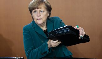 German Chancellor Angela Merkel arrives at the weekly cabinet meeting in Berlin, Germany, Wednesday, April 30, 2014. (AP Photo/Markus Schreiber)