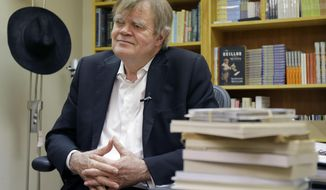 "This April 29, 2014 photo shows Garrison Keillor during an interview in his office in St. Paul, Minn. Keillor turns 72 in August, but the creator and host of ""A Prairie Home Companion"" isn't retiring any time soon.  (AP Photo/Ann Heisenfelt)"