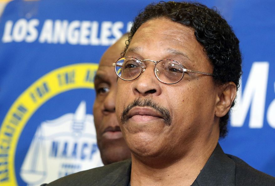 In this photo taken April 28, 2014, Leon Jenkins, president of the Los Angeles chapter of the NAACP, announces that Los Angeles Clippers basketball team owner Donald Sterling will not be receiving his lifetime achievement award, at a news conference in Culver City, Calif. Jenkins has his own legal problems, which are coming into focus now that the NBA has banned Sterling for racist comments. (AP Photo/Nick Ut)