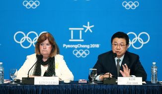 Kim Jin-sun, head of the Pyeongchang Organizing Committee for the 2018 Winter Olympic Games, right, speaks during a press conference as Gunilla Lindberg, chair of the IOC Evaluation Commission, listens in Pyeongchang, South Korea, Thursday, May 1, 2014. The IOC is convinced that preparations for the 2018 Winter Games in Pyeongchang are on track, in contrast with concerns over the chronic construction delays for the 2016 Olympics in Rio de Janeiro.(AP Photo/Yonhap)  KOREA OUT
