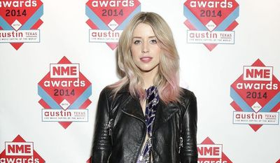 """FILE - In this Feb. 26, 2014 file photo Peaches Geldof, daughter of Bob Geldof is seen at the NME Awards 2014 in London. Peaches Geldof, the model and television presenter who was concert organizer Bob Geldof's daughter, has died at age 25. Bob Geldof said in a statement Monday, April 7, 2014: """"Peaches has died. We are beyond pain."""" (AP Photo/PA, Yui Mok) UNITED KINGDOM OUT, NO SALES, NO ARCHIVE"""