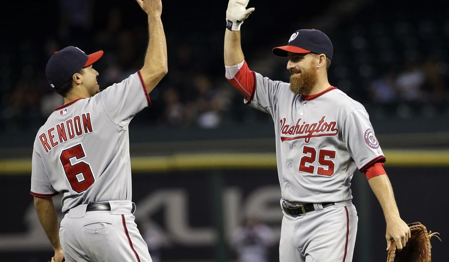 Washington Nationals' Adam LaRoche (25) celebrates with Anthony Rendon (6) after the Nationals defeated the Houston Astros 4-3 in a baseball game Tuesday, April 29, 2014, in Houston. (AP Photo/David J. Phillip)