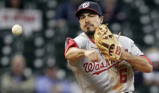 Washington Nationals third baseman Anthony Rendon fields a ball during the eighth inning of a baseball game against the Houston Astros, Wednesday, April 30, 2014, in Houston. (AP Photo/Patric Schneider)