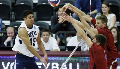 BYU's Taylor Sander (15) reacts after Stanford's Conrad Kaminski (4) and James Shaw, right, blocked the ball during the second set of an NCAA men's college volleyball tournament semifinals in Chicago on Thursday, May 1, 2014. (AP Photo/Nam Y. Huh)
