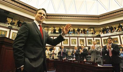 Florida House Speaker Will Weatherford, R- Wesley Chapel,  waves to members of the House after he completed his farewell speech, Friday, May 2, 2014, the last day of the 60 day session in Tallahassee. (AP Photo/The Tampa Bay Times, Scott Keeler)