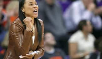 FILE - In this March 25, 2014, file photo, South Carolina head coach Dawn Staley yells to her team during the first half of a second-round game against Oregon State in the NCAA women's college basketball tournament in Seattle. After a landmark season that saw the Gamecocks earn win the Southeastern Conference regular-season title and earn a No. 1 seed in the NCAA tournament,  Staley landed the country's top college prospect in A'ja Wilson, setting off championship dreams among the fans who've gotten on board with the rising program. (AP Photo/Stephen Brashear, File)