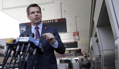 Rep. Eric Swalwell D-Calif, holds a news conference at the San Jose International Airport on Friday, May 2, 2014, in San Jose. (AP Photo/Marcio Jose Sanchez) ** FILE **
