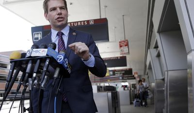 Rep. Eric Swalwell D-Calif, holds a news conference at the San Jose International Airport on Friday, May 2, 2014, in San Jose. Almost two weeks after a California teen survived a stowaway flight in a jet wheel well to Hawaii, Swalwell did his own perimeter tour of San Jose International Airport where authorities have yet to say if they know where their security was breached. (AP Photo/Marcio Jose Sanchez)