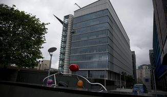 An exterior view of the Two Kingdom Street building which houses the headquarters of AstraZeneca, in the Paddington area of London, Friday, May 2, 2014.  The board of pharmaceutical company AstraZeneca on Friday rejected drug maker Pfizer's sweetened takeover offer. Pfizer earlier in the day said it is offering 50 pounds ($84) a share in cash and stock, a 7.3 increase on a previous bid. The offer values AstraZeneca at $106 billion. (AP Photo/Matt Dunham)