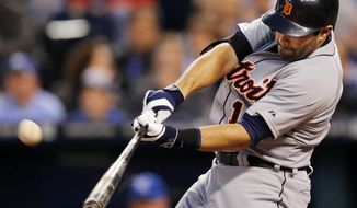 Detroit Tigers' Alex Avila hits a two-run home run off Kansas City Royals starting pitcher James Shields during the fourth inning of a baseball game in Kansas City, Mo., Friday, May 2, 2014. (AP Photo/Orlin Wagner)