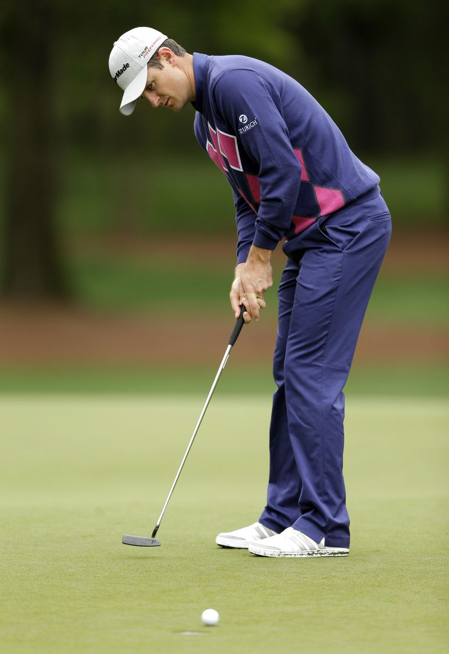 Justin Rose, of England, putts on the 13th hole during the second round of the Wells Fargo Championship golf tournament in Charlotte, N.C., Friday, May 2, 2014. (AP Photo/Chuck Burton)