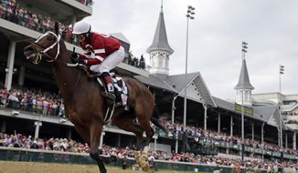 Rosie Napravnik rides Untapable to victory during the 140th running of the Kentucky Oaks horse race at Churchill Downs Friday, May 2, 2014, in Louisville, Ky. (AP Photo/David J. Phillip)