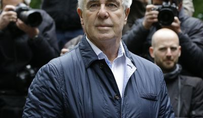 Max Clifford arrives for sentencing at Southwark Crown Court in London, Friday, May 2, 2014. Clifford, once one of the most powerful figures in the British entertainment world, could face jail today when he is sentenced for a string of indecent assaults. Clifford, 71, was found guilty Monday of eight counts of indecent assault stemming from attacks on teenagers dating back more than 40 years. (AP Photo/Kirsty Wigglesworth)