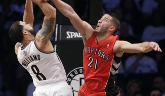 Toronto Raptors' Greivis Vasquez (21) fouls Brooklyn Nets' Deron Williams (8) during the first half of Game 6 of the opening-round NBA basketball playoff series Friday, May 2, 2014, in New York. (AP Photo/Frank Franklin II)