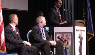 Republican U.S. Senate hopeful Joe Miller, standing at podium, delivers his opening remarks during a candidate forum at the state GOP convention on Friday, May 2, 2014, in Juneau, Alaska. Shown, from left, are fellow Republican candidates Dan Sullivan and Mead Treadwell. (AP Photo/Becky Bohrer)