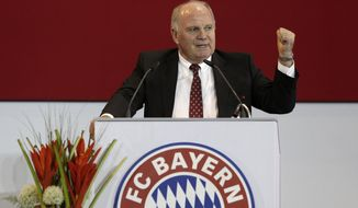 Former FC Bayern Munich president Uli Hoeness gestures during his speech at an extraordinary members meeting, in Munich, southern Germany, Friday, May 2, 2014. The club is voting for a new president. (AP Photo/Matthias Schrader)