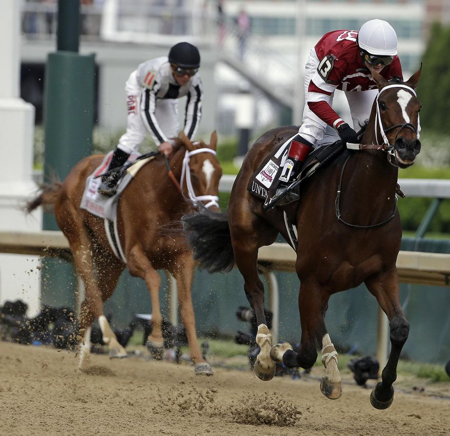 Rosie Napravnik rides Untapable to victory during the 140th running of the Kentucky Oaks horse race at Churchill Downs Friday, May 2, 2014, in Louisville, Ky. (AP Photo/David Goldman)