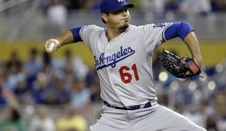 Los Angeles Dodgers starting pitcher Josh Beckett (61) throws in the first inning of a baseball game against the Miami Marlins, Friday, May 2, 2014, in Miami. (AP Photo/Lynne Sladky)