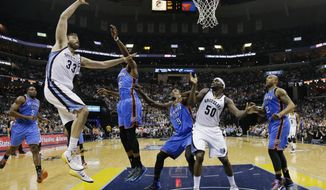 Memphis Grizzlies center Marc Gasol (33) shoots over Oklahoma City Thunder forward Kevin Durant (35) in the second half of Game 6 of an opening-round NBA basketball playoff series Thursday, May 1, 2014, in Memphis, Tenn. Memphis Grizzlies forward Zach Randolph (50), Oklahoma City Thunder forward Serge Ibaka (9) and forward Caron Butler (2) watch for the rebound. Oklahoma City won 104-84 to even the series 3-3. (AP Photo/Mark Humphrey)