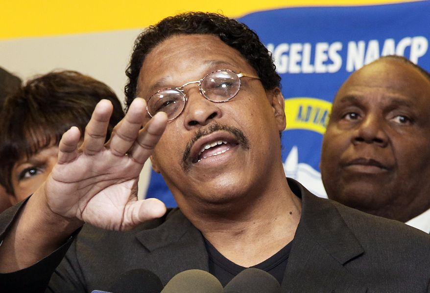 ** FILE ** In this April 28, 2014, file photo, Leon Jenkins, president of the Los Angeles chapter of the NAACP, announces that Los Angeles Clippers basketball team owner Donald Sterling will not be receiving his lifetime achievement award, at a news conference in Culver City, Calif. (AP Photo/Nick Ut, File)