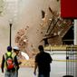 A portion of the front facade of the Cloakroom Gentlemen's Club building collapses about an hour after the inside collapsed at the corner of 4th and K Streets NW, Washington, D.C., Friday, May 2, 2014. (Andrew Harnik/The Washington Times)