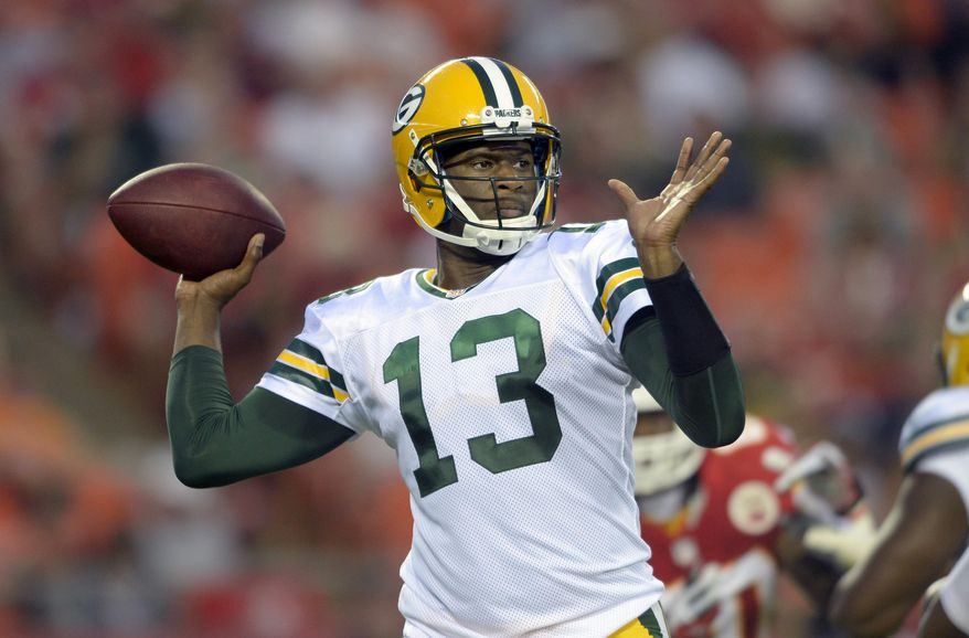 ADVANCE FOR USE WEEKEND, MAY 3-4 - FILE - In this Aug. 29, 2013, file photo, Green Bay Packers quarterback Vince Young looks to throw against the Kansas City Chiefs during the first half of their NFL football game in Kansas City, Mo., Thursday, Aug. 29, 2013. The third pick in the 2006 draft out of Texas, Young was at the forefront of the new wave of dual-threat quarterbacks to enter the league. But he had a falling out with the team, struggled to stay healthy and has not appeared in an NFL game since 2011. (AP Photo/Reed Hoffmann, File)