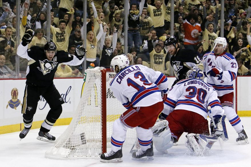 Pittsburgh Penguins' James Neal (18) celebrates his goal past New York Rangers goalie Henrik Lundqvist (30) with teammate Evgeni Malkin (71) during the second period of Game 1 of a second-round NHL hockey playoff series in Pittsburgh, Friday, May 2, 2014. (AP Photo/Gene J. Puskar)