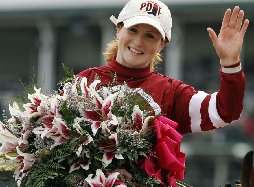 Rosie Napravnik celebrates after riding Untapable to victory during the 140th running of the Kentucky Oaks horse race at Churchill Downs Friday, May 2, 2014, in Louisville, Ky. (AP Photo/Garry Jones)