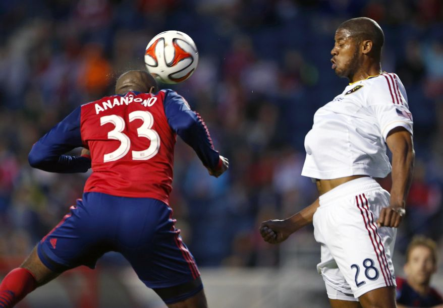 Chicago Fire forward Juan Luis Anangono, left, goes for a header against Real Salt Lake defender Chris Schuler, right, during the first half of an MLS soccer game on Saturday, May 3, 2014, at Toyota Park in Bridgeview, Ill. (AP Photo/Kamil Krzaczynski)