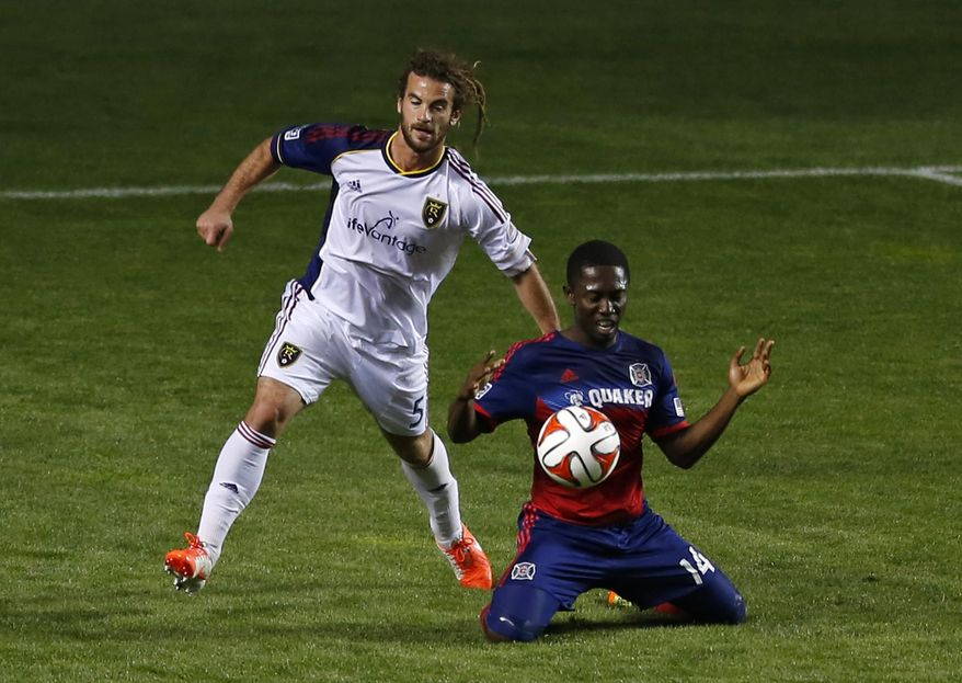 Real Salt Lake midfielder Kyle Beckerman, left, fouls Chicago Fire forward Patrick Nyarko, right, during the first half of an MLS soccer game on Saturday, May 3, 2014, at Toyota Park in Bridgeview, Ill. (AP Photo/Kamil Krzaczynski)