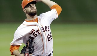 Houston Astros' Dallas Keuchel delivers a pitch against the Seattle Mariners in the first inning of a baseball game on Saturday, May 3, 2014, in Houston. (AP Photo/Pat Sullivan)