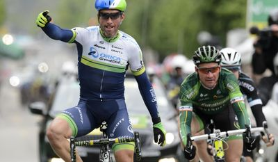 Switzerland's Michael Albasini, left, of team Orica Greenedge, rises his arms after crossing the finish line to win the 4th stage in front of second placed French cyclist Thomas Voeckler, right, of Europcar team, a 173,1 km race from Fribourg to Fribourg, at the 68th Tour de Romandie UCI ProTour cycling race in Fribourg, Switzerland, Saturday, May 3, 2014. (AP Photo/Keystone, Laurent Gillieron)