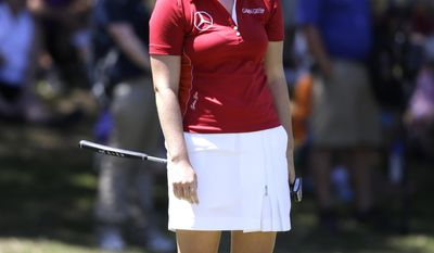 Caroline Masson, of Germany, reacts to missing a putt on the ninth hole during the third round of the North Texas LPGA Shootout golf tournament at Las Colinas Country Club in Irving, Texas, Saturday, May 3, 2014. (AP Photo/LM Otero)