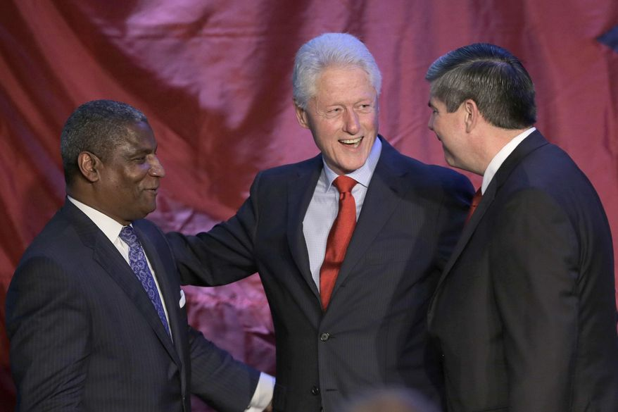 Former President Bill Clinton, center, talks with former Transportation Secretary Rodney Slater, left, and former Democratic Congressman Mike Ross at a Ross fundraiser in Little Rock, Ark., Saturday, May 3, 2014. Ross is seeking the Democratic Party nomination in the race for Arkansas governor. (AP Photo/Danny Johnston)