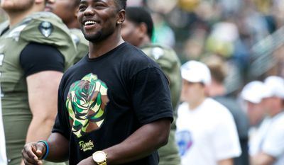 Former Oregon player Kenjon Barner watches the Ducks spring NCAA college football game on Saturday, May 3, 2014, at Autzen Stadium in Eugene, Ore. (AP Photo/The Oregonian, Thomas Boyd)  MAGS OUT; TV OUT; LOCAL TV OUT; LOCAL INTERNET OUT; THE MERCURY OUT; WILLAMETTE WEEK OUT; PAMPLIN MEDIA GROUP OUT