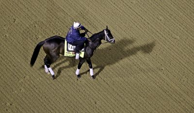 Exercise rider Nick Bush takes Kentucky Derby entrant We Miss Artie for a morning workout during a morning workout at Churchill Downs Friday, May 2, 2014, in Louisville, Ky. (AP Photo/Charlie Riedel)