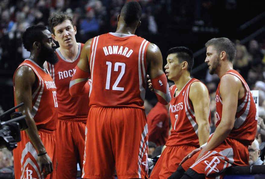 Houston Rockets' Dwight Howard (12) talks with teammates during a timeout against the Portland Trail Blazers during the first half of game six of an NBA basketball first-round playoff series game in Portland, Ore., Friday May 2, 2014. (AP Photo/Greg Wahl-Stephens)